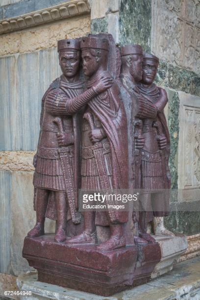 Venice Venice Province Veneto Region Italy Porphyry sculpture group outside St Mark's Basilica of four Roman emperors dating from around 300 AD and...