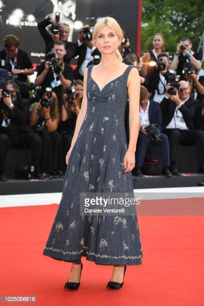 Venice Virtual Reality jury member Clemence Poesy walks the red carpet ahead of the opening ceremony and the 'First Man' screening during the 75th...