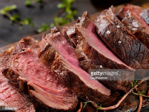 venison, elk sirloin tip roast - meat stock pictures, royalty-free photos & images