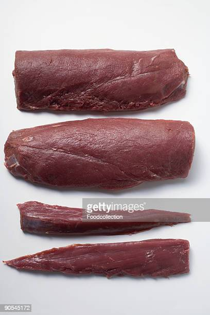 venison fillets on white background, close up - carne de cervo - fotografias e filmes do acervo