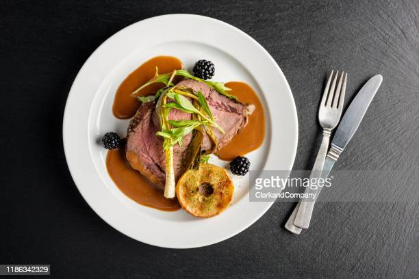 venison with apple and seasonal vegetables. - roast dinner stock pictures, royalty-free photos & images