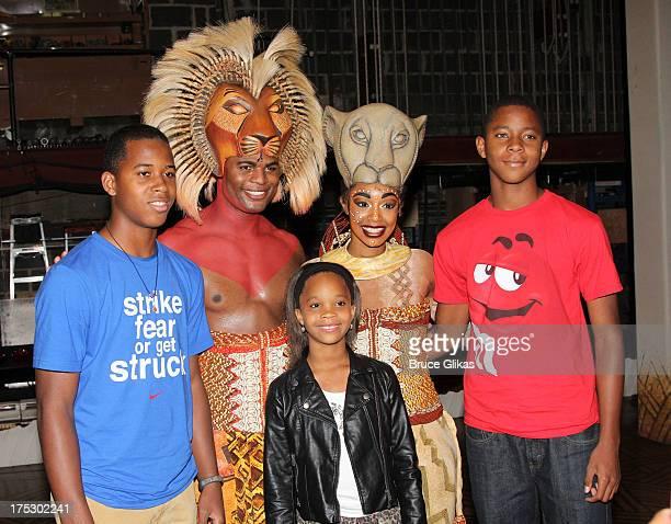 Venjie Jr Wallis Andile Gumbi as Simba Quvenzhané Wallis Chantel Riley as Nala and Vejon Wallis pose backstage at the hit musical The Lion King on...