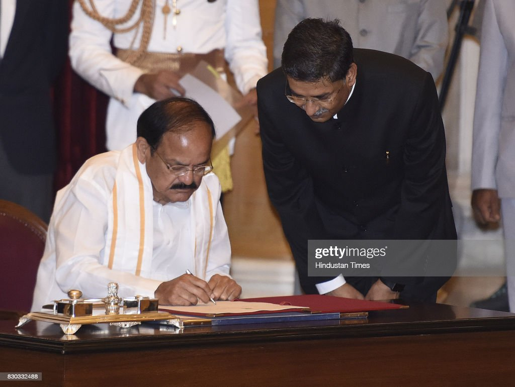 Venkaiah Naidu as the 13th VicePresident of India sign the paper after take administering Oath by President of India Ram Nath Kovind at Darbar Hall...