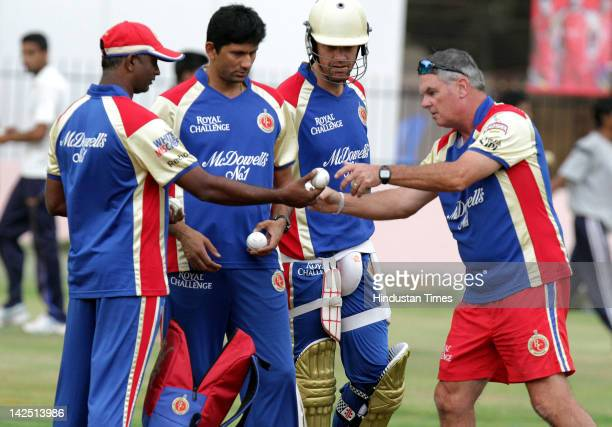 Venkatesh Prasad and Andrew McDonald of Royal Challengers Bangalore speak with members of the coaching staff during a practice session at...