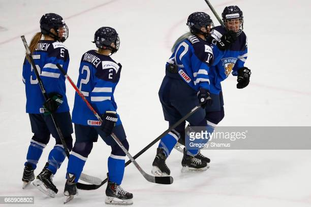 Venla Hovi of Finland celebrates her first period goal with Linda Valimaki, Isa Rahunen, and Anna Kilponen while playing Germany in the bronze medal...