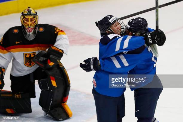 Venla Hovi of Finland celebrates her fist period goal with Yvonne Rothemund next to Jennifer Harss of Germany in the bronze medal game at the 2017...