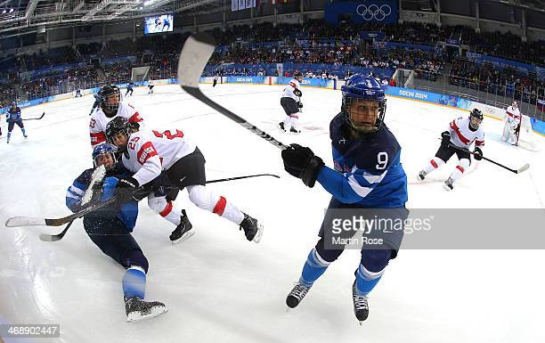 Venla Hovi of Finland goes for the puck against Switzerland in the third period during the Women's Ice Hockey Preliminary Round Group A game on day...