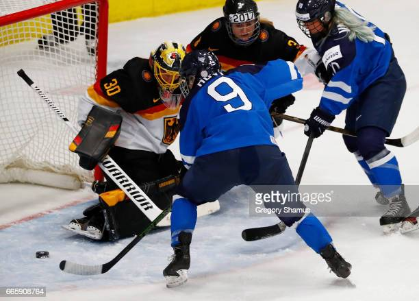 Venla Hovi of Finland scores a first period goal past Jennifer Harss of Germany in the bronze medal game at the 2017 IIHF Woman's World Championships...