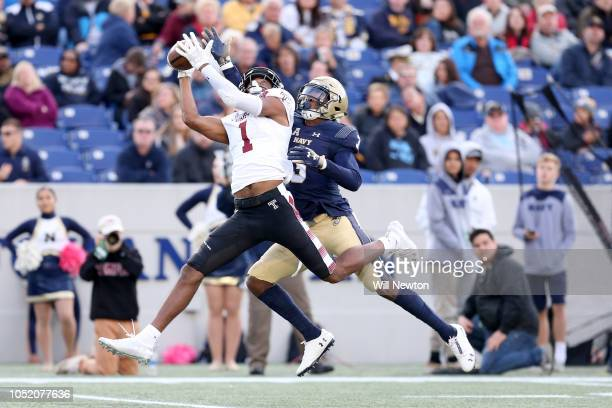 Ventell Bryant of the Temple Owls catches a pass over Cameron Kinley of the Navy Midshipmen during the second half at NavyMarines Memorial Stadium on...
