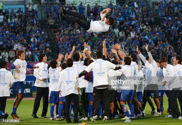 Ventforet Kofu head coach Hiroshi Jofuku is thrown into the air after the J.League second division match between Ventforet Kofu and Shonan Bellmare...