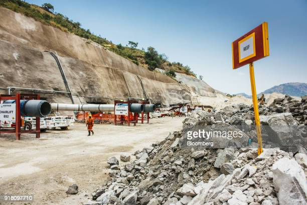 Ventilation shaft pipework stands by a stockpile of raw aluminum containing ore mined from the Upper Group 2 Reef platinum rich rock layer at the...