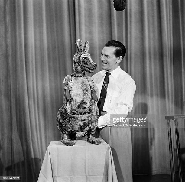 Ventriloquist Clifford Guest with his puppet Katie perform on the Toast of the Town show hosted by Ed Sullivan at the Maxine Elliott Theater in New...