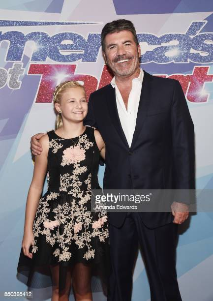 Ventriloquist Darci Lynne and Simon Cowell attends NBC's 'America's Got Talent' Season 12 Finale at the Dolby Theatre on September 20 2017 in...