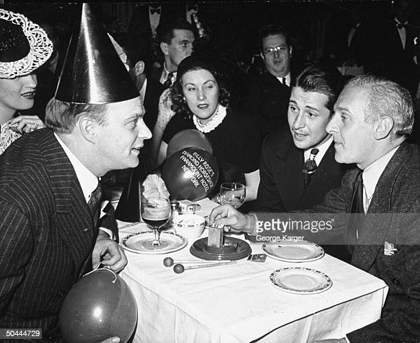 Ventriloquist Edgar Bergen actress Dorothy Lamour actor Don Ameche and columnist Walter Winchell attending a party at the Diamond Horseshoe nightclub