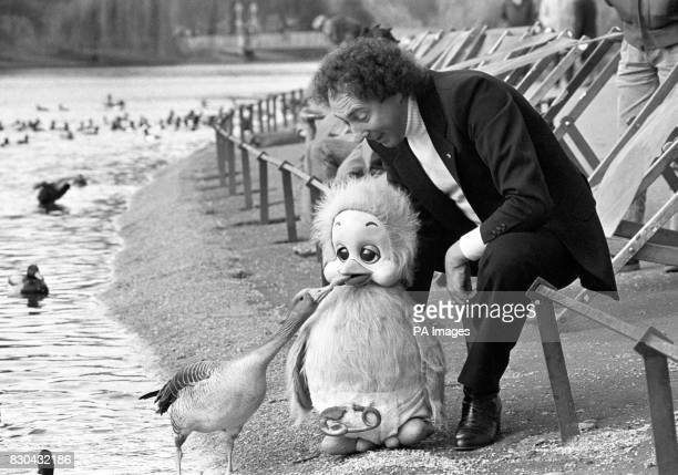 Ventriloquist Keith Harris and his puppet Orville feed a goose in St James's Park London to launch a 'AdoptaDuck Savings Account' launched jointly by...