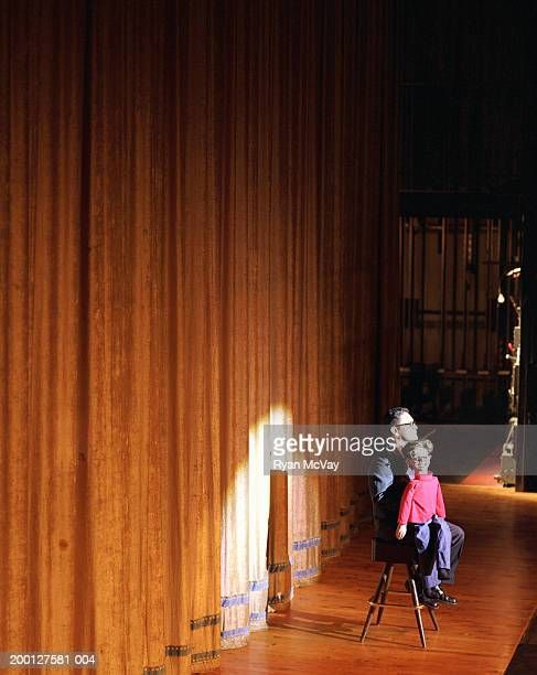 ventriloquist on stage with dummy - ventriloquist stock photos and pictures