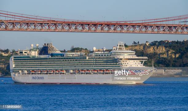 Ventura a Grandclass cruise ship of the PO Cruises fleet sails the Tagus River under 25 de Abril Bridge while leaving harbor at the end of the...