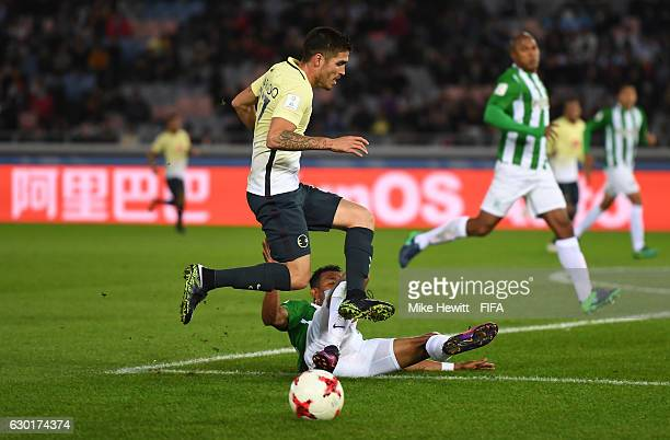 Ventura Alvarado of Club America is tackled by Farid Diaz of Atletico Nacional during the FIFA Club World Cup 3rd Place match between Club America...
