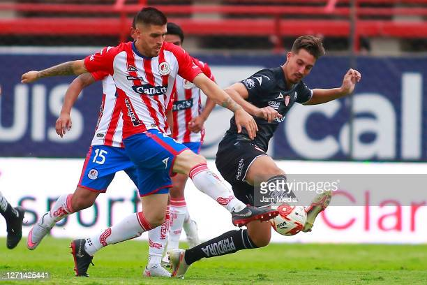 Ventura Alvarado of San Luis fights for the ball with Ian Gonzalez of Necaxa during the 9th round match between Atletico San Luis and Necaxa as part...