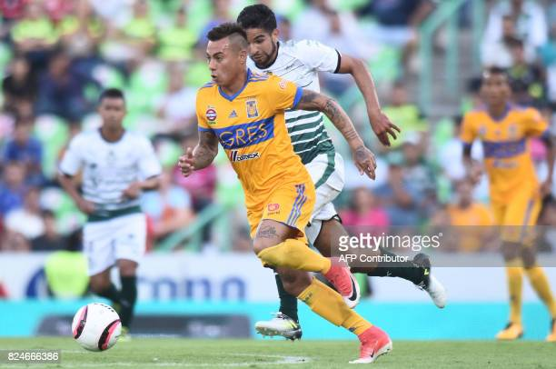Ventura Alvarado of Santos vies for the ball with Eduardo Vargas of Tigres during their Mexican Apertura 2017 Tournament football match at the TSM...
