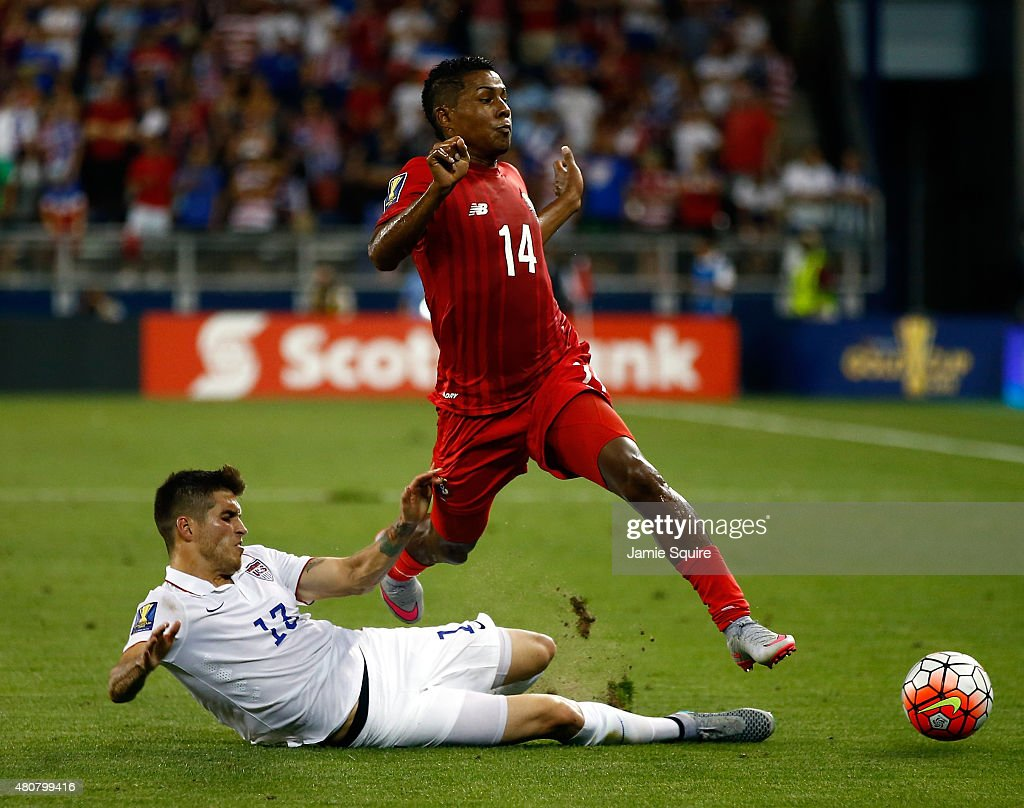 Ventura Alvarado #13 of the USA slide tackles Miguel Camargo #14 of Panama during the CONCACAF Gold Cup match at Sporting Park on July 13, 2015 in Kansas City, Kansas.
