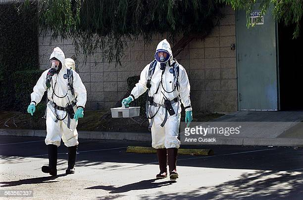 Ventura City Fire Department Hazmat team L to R Brian Dwight and Bill Santino leave Clark American in Ventura with a white powder that was discovered...