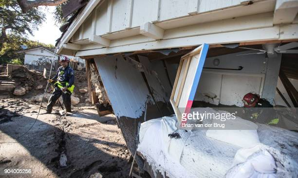 MONTECITO CALIF THURSDAY JANUARY 11 2018 Ventura County fire captain Clay Cundiff right and captain Scott Sato left search in and around a home for a...