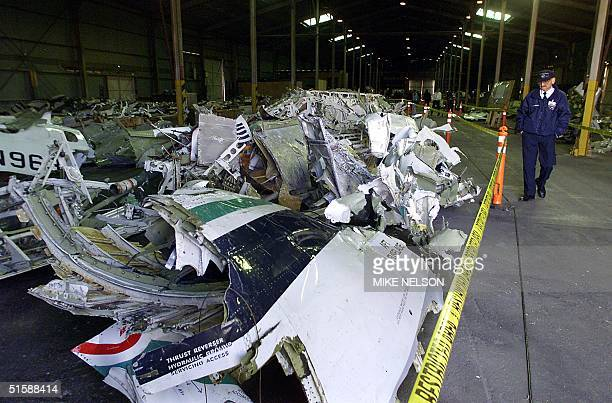 Ventura County Fire Department Captain Tom Kruschke looks at the wreckage of Alaska Airlines flight 261 in Port Hueneme CA 31 January 2001 The NTSB...