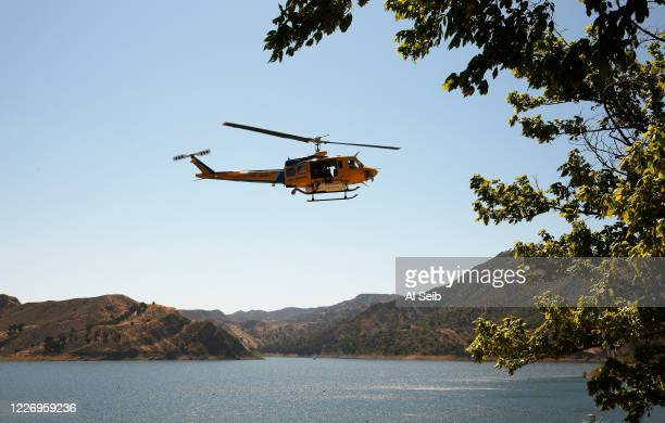 Ventura County Fire helicopter assisted in the search with Sheriffs Search and Rescue dive team as they located a body Monday morning in Lake Piru as...