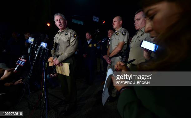 Ventura County Sheriff Geoff Dean briefs reporters at the intersection of US 101 freeway and the Moorpark Rad exit as police vehicles close off the...
