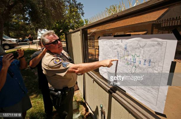 Ventura County Sheriff Sgt Kevin Donoghue posts a map of search sites after Ventura County Sheriffs Search and Rescue dive team located a body Monday...
