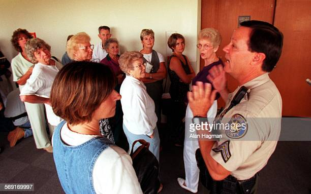 Ventura County Sheriffs' deputy Stan Webber informs people waiting for a seat inside the courtroom for the Diana Haun trial that all seats have been...