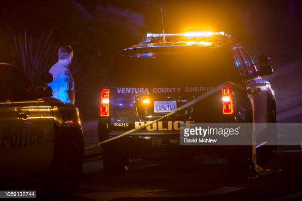 Ventura County Sheriffs officer stands near a vehicle near the Borderline Bar and Grill where a mass shooting occurred on November 8 2018 in Thousand...