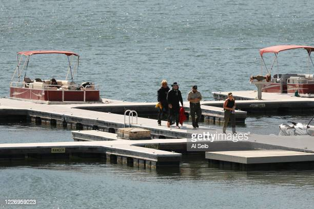 Ventura County Sheriff's Search and Rescue dive team return to the marina after they located a body Monday morning in Lake Piru as the search...