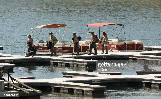 Ventura County Sheriffs Search and Rescue dive team return to the marina after they located a body Monday morning in Lake Piru as the search...