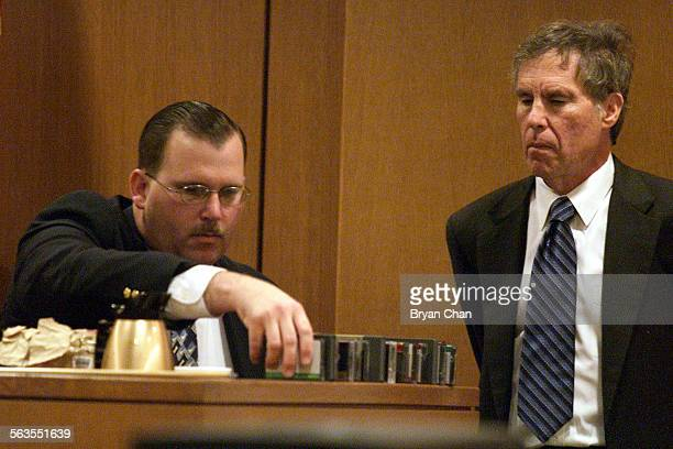 Ventura County Sheriff's Senior Deputy Scott Peterson left puts out video tapes collected in a search of Andrew Luster's home while Luster's attorney...