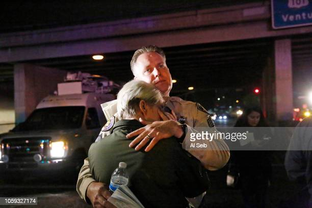 Ventura County sheriff's Sgt. Eric Buschow comforts Sgt. Julie Novak at the scene of the Borderline mass shooting in on November 8, 2018 in Thousand...