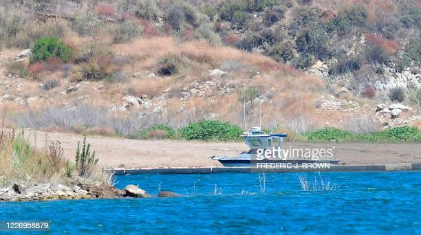 Ventura County Sheriff's vessel is seen near the north cove at Lake Piru, north of Los Angeles, California, on July 13 where a body presumed to be...