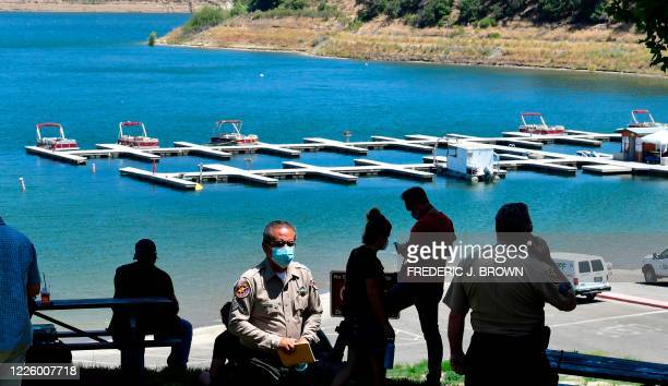 Ventura County sheriffs work at Lake Piru in the Los Padres National Forest, Ventura County, California on July 9, 2020 as the search continues for...