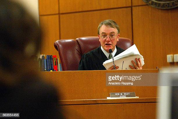Ventura County Superior Court Judge Ken Riley holding 86 guilty verdicts talks to attorneys after the verdicts were read in the Andrew Luster rape...