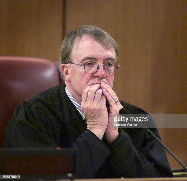 Ventura County Superior Court Judge Ken Riley listens as attorneys discuss the whereabouts of Andrew Luster in Ventura County Superior Court in...