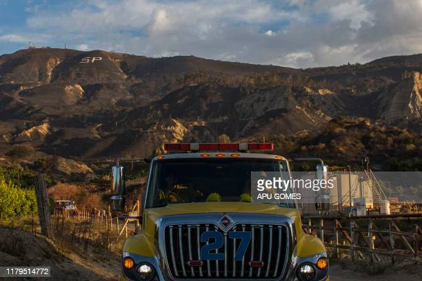 Ventura firefighters patrol the burned areas of the Maria Fire in Santa Paula Ventura County California on November 02 2019