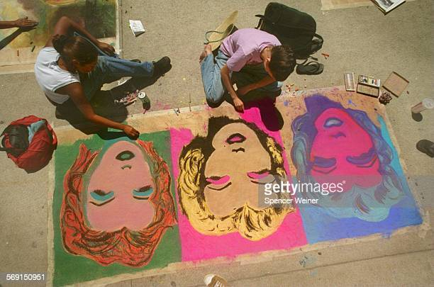 Ventura high school students Elizabeth Gutierrez and Tisa Hall work on their version of the Andy Warhol's 'Marilyn Monroe 1967' during the HS's...