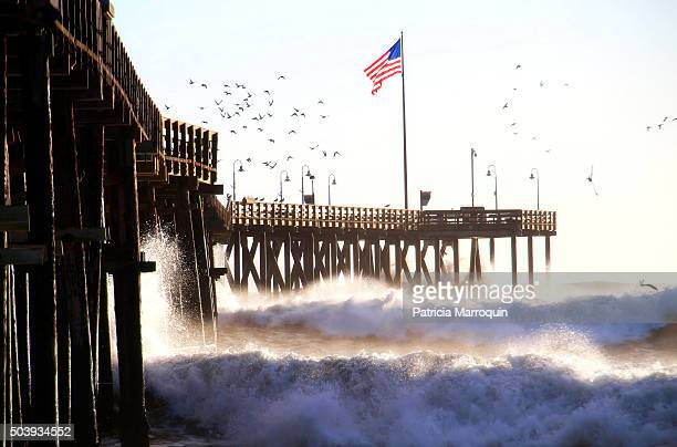 ventura pier flag, waves, and birds - american flag ocean stock pictures, royalty-free photos & images