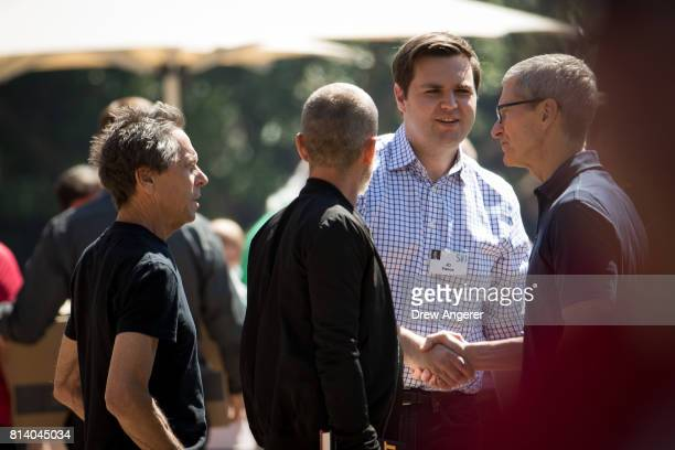 Venture capitalist and author JD Vance shakes hands with Tim Cook chief executive officer of Apple on the third day of the annual Allen Company Sun...