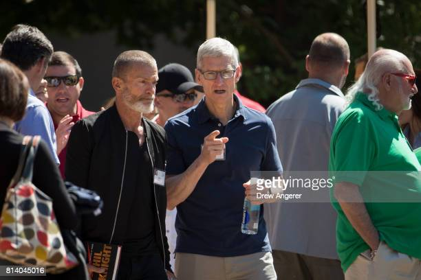 Venture capitalist Aviv 'Vivi' Nevo talks with Tim Cook, chief executive officer of Apple, on the third day of the annual Allen & Company Sun Valley...