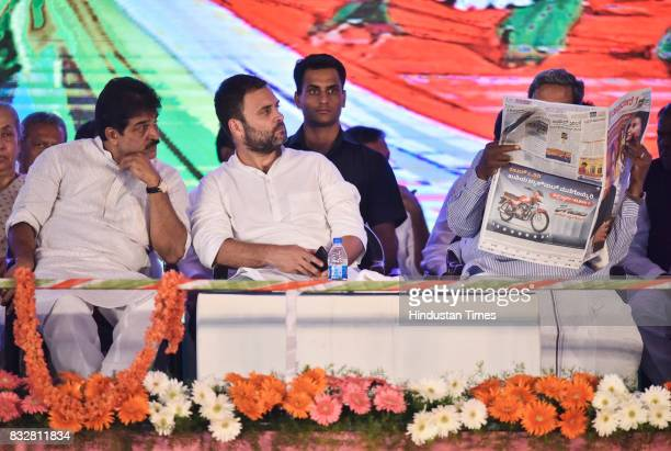 KC Venugopal Congress Vice President Rahul Gandhi listen to KPCC President's speech as Karnataka Chief Minister Siddaramaiah reads newspaper during a...