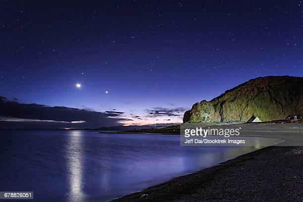 Venus and Jupiter dance in the evening twilight over Lake Namtso, Tibet, China.
