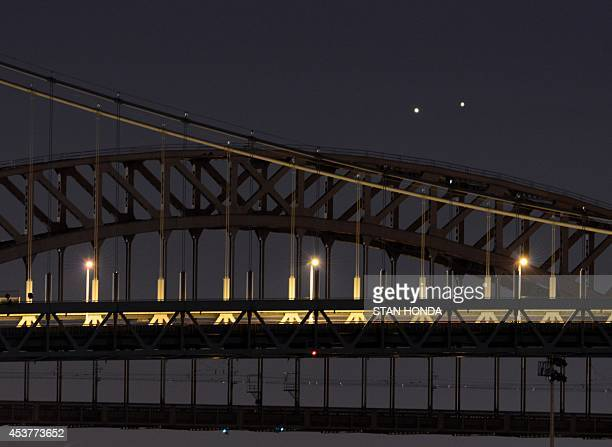 Venus and Jupiter rise together in a rare conjunction over the Hell Gate and Robert F Kennedy Bridges in the early morning of August 18 2014 in New...