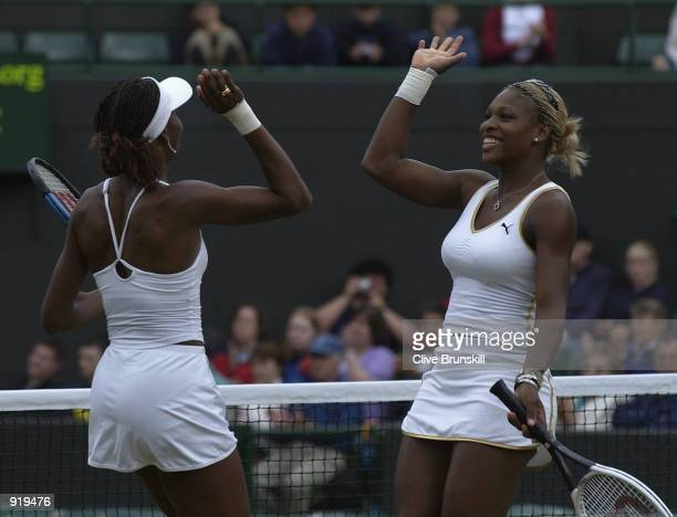 Venus and Serena Williams of the USA in action during their womens doubles match against Tina Krizan and Katarina Srebotnik of Slovenia at the All...